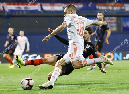 Spain's Jose Gaya, top, challenges for the ball with Croatia's Sime Vrsaljko during the UEFA Nations League soccer match between Croatia and Spain at the Maksimir stadium in Zagreb, Croatia