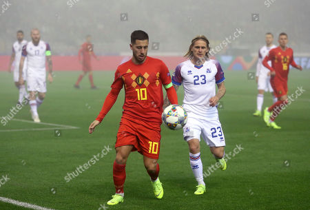 Belgium's Eden Hazard, center left, vies for the ball with Iceland's Ari Skulason, center right, during the UEFA Nations League soccer match between Belgium and Iceland at the King Baudouin stadium in Brussels