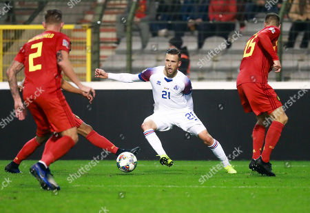 (L-R) Toby Alderweireld of Belgium, Arnor Ingvi Traustason of Iceland and Thomas Meunier of Belgium fight for the ball during the Nations League soccer match, League A, Group 2, between Belgium and Iceland at the King Baudouin stadium in Brussels, Belgium, 15 November 2018.