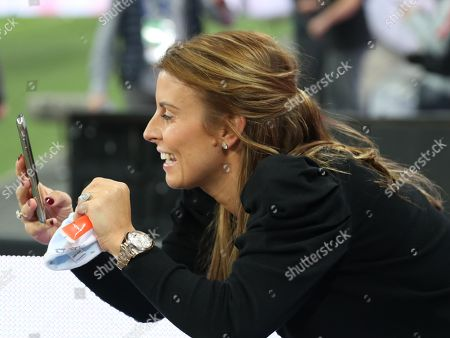 Stock Image of Coleen Rooney takes photograph