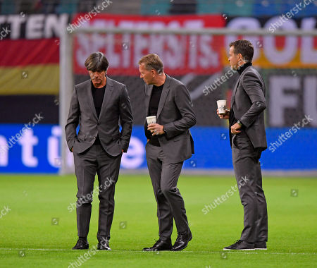 Stock Picture of 16.10.2018, Football, Nationalteams, international friendly, Germany - Russia, in Red Bull Arena Leipzig. , v.li: Bundestrainer Joachim Loew (Germany), goalkeepertrainer Andreas Koepke (Germany) , Manager Oliver Bierhoff (Germany) .
