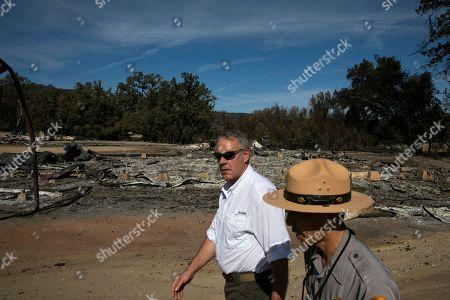 U.S. Secretary of the Interior Ryan Zinke, center, visits decimated Paramount Ranch, in Agoura Hills, Calif. The landmark film location was burned to the ground by the Woolsey Fire