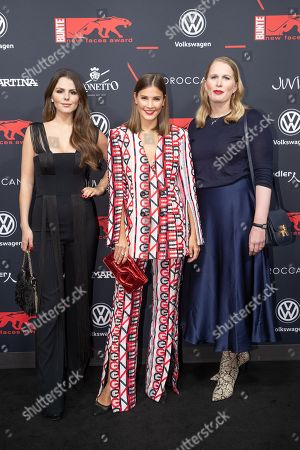 Winner of the Young Style Icon award Ruby O. Fee, winner of the Style Influencer award Nina Schwichtenberg and winner of the Young Fashion Designer award Lilly Ingenhoven arrive for the New Faces Award 2018 ceremony in Berlin, Germany, 15 November 2018. The New Faces Award is a young talent prize that has been presented by the German weekly Bunte since 1998.