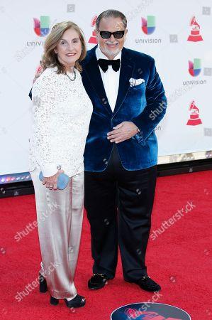Raul De Molina, Millie de Molina. Raul De Molina, right, and Millie de Molina