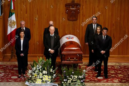 (L-R) Mexican Culture Secretary Maria Cristina Garcia, Rector of the University of Guadalajara Miguel Angel Navarro and Jalisco Governor Aristoteles Sandoval stand next to the coffin of Mexican writer Fernando del Paso at the University of Guadalajara in Jalisco, Mexico, 15 November 2018. Mexico paid tribute to Del Paso, who died at the age of 83.