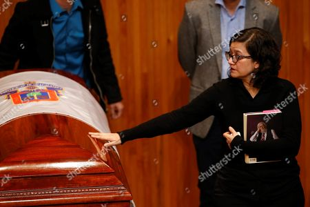 Stock Photo of Paulina del Paso, daughter of Mexican writer Fernando del Paso, touches her father's coffin at the University of Guadalajara in Jalisco, Mexico, 15 November 2018. Mexico paid tribute to Del Paso, who died at the age of 83.