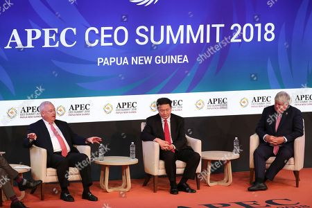 Stock Image of President of Underwriters Laboratories Terrence Brady (L), CEO of CreditEase Ning Tang (C) and Chairman & Founder of Digicel Group Denis O?Brien (R) during the APEC CEO Summit 2018 in Port Moresby, Papua New Guinea, 16 November 2018. The 30th Asia-Pacific Economic Cooperation (APEC) summit brings together world leaders from its 21 Pacific Rim member nations and is being hosted for the first time by Papua New Guinea on 17 and 18 November 2018.