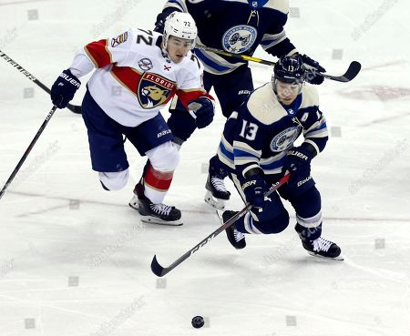 Stock Photo of Columbus Blue Jackets forward Cam Atkinson, right, chases the puck against Florida Panthers forward Frank Vatrano during the third period of an NHL hockey game in Columbus, Ohio, . The Blue Jackets won 7-3
