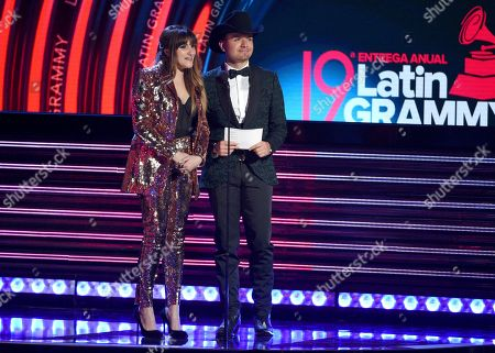 Rozalen, left, and El Dasa present the award for best norteno album