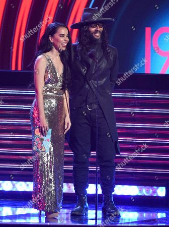 Beatriz Luengo, Draco Rosa. Beatriz Luengo, left, and Draco Rosa present the award for best urban music album at the Latin Grammy Awards, at the MGM Grand Garden Arena in Las Vegas