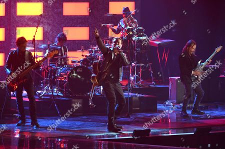 Juan Calleros, Alex Gonzalez, Fher Olvera, Sergio Vallin. Juan Calleros, from left, Alex Gonzalez, Fher Olvera and Sergio Vallin, of Mana, winners of the award for Person of the Year, perform at the Latin Grammy Awards, at the MGM Grand Garden Arena in Las Vegas
