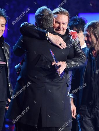 Miguel Bose, Fher Olvera. Miguel Bose, left, congratulates Fher Olvera, of Mana, winners of the award for Person of the Year, at the Latin Grammy Awards, at the MGM Grand Garden Arena in Las Vegas