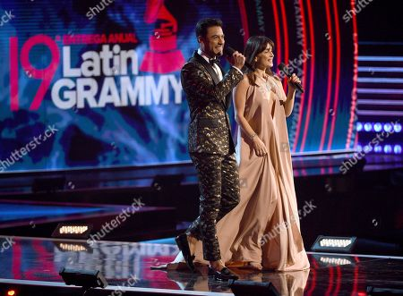 Hosts Carlos Rivera, left, and Ana de la Reguera speak