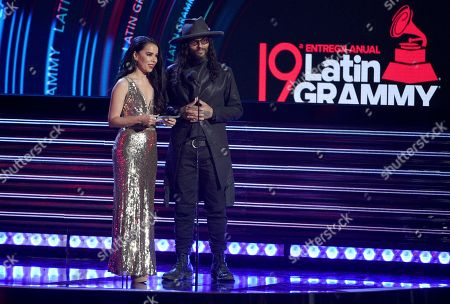 Beatriz Luengo, Draco. Beatriz Luengo, left, and Draco present the award for best urban music album at the Latin Grammy Awards, at the MGM Grand Garden Arena in Las Vegas