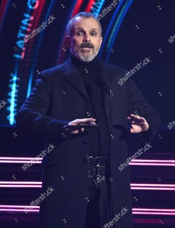 Miguel Bose introduces a performance by Person of the Year honorees Mana at the Latin Grammy Awards, at the MGM Grand Garden Arena in Las Vegas