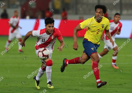 Peru's Raul Ruidiaz (L) vies for the ball with Ecuador's Arturo Mina (R) during the friendly soccer match between the national soccer teams of Peru and Ecuador at National stadium in Lima, Peru, 15 November 2018.