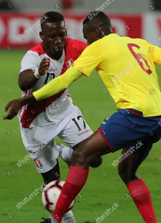 Peru's Raul Ruidiaz (L) vies for the ball with Ecuador' Arturo Mina (R) during the friendly soccer match between the national soccer teams of Peru and Ecuador at National stadium in Lima, Peru, 15 November 2018.