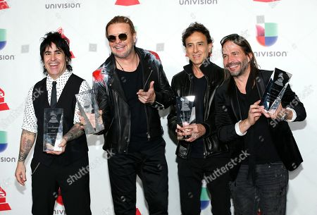 Alex Gonzalez, Fher Olvera, Juan Calleros, Sergio Vallin. Alex Gonzalez, from left, Fher Olvera, Juan Calleros and Sergio Vallin, of Mana, pose in the press room with the award for Person of the Year at the Latin Grammy Awards, at the MGM Grand Garden Arena in Las Vegas