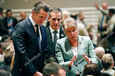 California Governor elect Gavin Newsom (L), Los Angeles Mayor Eric Garcetti (C) and US Representative Julia Brownley (R) talk to Jason Coffman (not pictured), father of Cody Gifford-Coffman, one of 12 killed by a gunman last week, before a memorial service for Ventura County Sheriff Sergeant Ron Helus at Calvary Community Church in Westlake Village, California, USA, 15 November 2018. Sergeant Helus was one of 12 victims of the Borderline Bar and Grill mass shooting in Thousand Oaks last week.