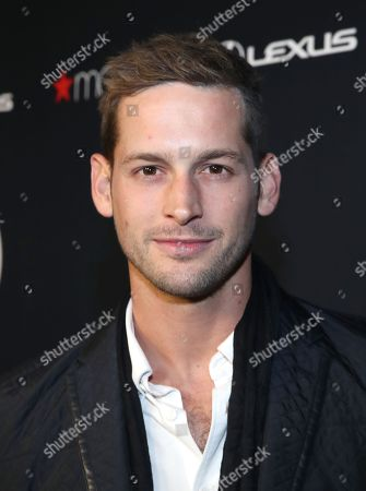 Stock Photo of Max Emerson attends the OUT Magazine's OUT100 Celebration Presented by Lexus, held at Quixote Studios