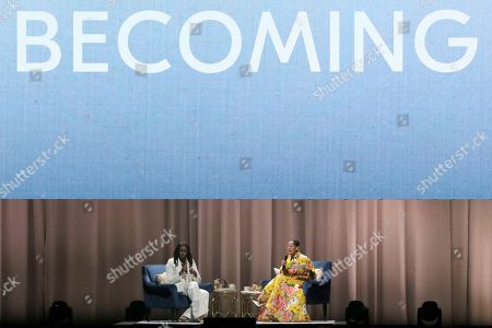 "Stock Image of Michelle Obama, Tracee Ellis Ross. Former first lady Michelle Obama, left, and Tracee Ellis Ross speak at the ""Becoming: An Intimate Conversation with Michelle Obama "" event at the Forum, in Inglewood, Calif"