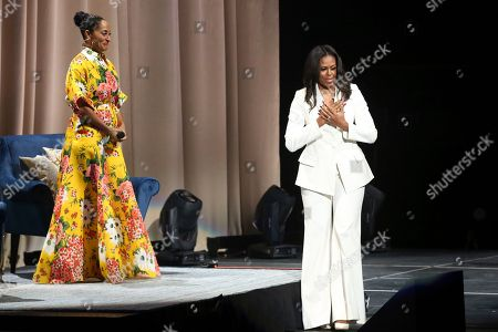 "Stock Picture of Tracee Ellis Ross, Michelle Obama. Former first lady Michelle Obama, right, thanks the love showed by the audience as Tracee Ellis Ross smiles at the ""Becoming: An Intimate Conversation with Michelle Obama "" event at the Forum, in Inglewood, Calif"