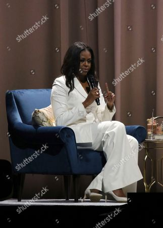 "Michelle Obama speaks at the ""Becoming: An Intimate Conversation with Michelle Obama "" event at the Forum, in Inglewood, Calif"