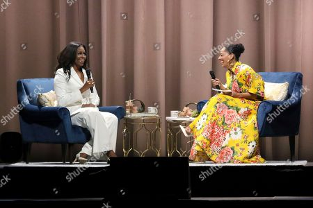 "Michelle Obama, Tracee Ellis Ross. Former first lady Michelle Obama, left, and Tracee Ellis Ross laugh during their conversation at the ""Becoming: An Intimate Conversation with Michelle Obama "" event at the Forum, in Inglewood, Calif"