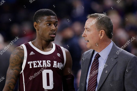 Texas A&M guard Jay Jay Chandler (0) speaks with head coach Billy Kennedy during the second half of an NCAA college basketball game against Gonzaga in Spokane, Wash