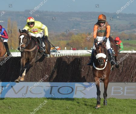 (L) Ibis Du Rheu (Harry Cobden) takes the last on the 2nd circuit before going on to win The maiiardjewellers.com Novices Chase from (R) Theatre Territory (Sam Waley-Cohen).