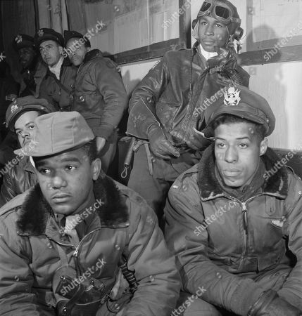 Tuskegee Airmen Attending Briefing, Foreground (left to right): Joseph L. 'Joe' Chineworth, Memphis, TN, Class 44-E; Emile G. Clifton, San Francisco, CA, Class 44-B; Richard S. Harder, Brooklyn, NY, Class 44-B. Along back wall (back to front): Frank N. Wright, Elmsford, NY, Class 44-F; Robert J. Murdic, Franklin, TN, Class 44-F; Jimmie D. Wheeler, Ramitelli, Italy, Toni Frissell, March 1945