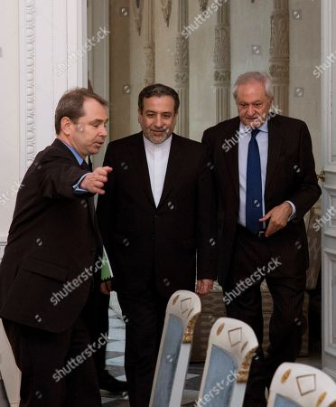 Spanish Secretary of State for Foreign Affairs, Fernando Martin Valenzuela (R) and Deputy Minister of Political Affairs of the Ministry of Foreign Affairs of Iran Seyed Abbas Araghchi (C) during their meeting at Viana Palace in Madrid, Spain, 16 November 2018.