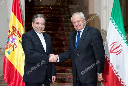Spanish Secretary of State for Foreign Affairs Fernando MartIn Valenzuela (R) greets Deputy Minister of Political Affairs of the Ministry of Foreign Affairs of Iran Seyed Abbas Araghchi (L) during their meeting at Viana Palace in Madrid, Spain, 16 November 2018.