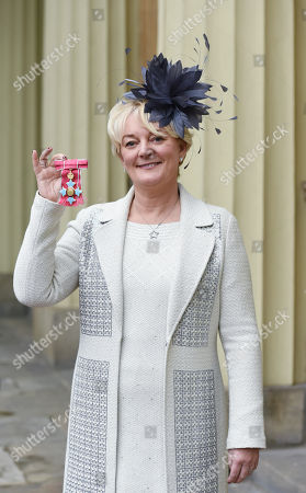 Jo Malone with her OBE, Proprietor, Jo Loves Ltd. for services to the British Economy and the GREAT Britain campaign, at Buckingham Palace.