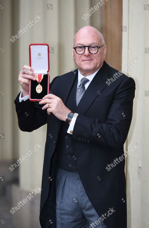 Stock Photo of Sir Lloyd Dorfman, Philanthropist, gets an OBE for services to Philanthropy and the Arts. At Buckingham Palace.