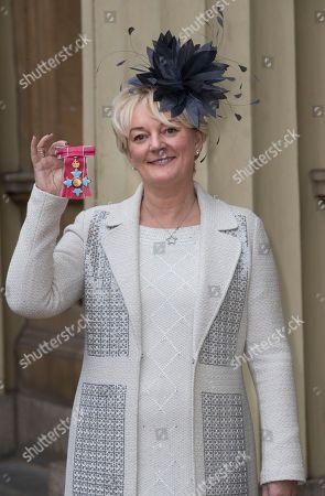 Jo Malone with her CBE after an Investiture at Buckingham Palace in London