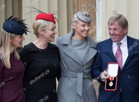 Sir Kenny Dalglish with his daughters from left: Lauren, Kelly and Lynsey after he received a Knighthood at an Investiture at Buckingham Palace in London