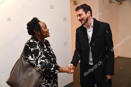 Stock Picture of South African Consul General in Milan, Titi Nxumalo (L) and Palazzo Ducale president Luca Bizzarri (R) shake hands on the sidelines of the presentation of the exhibition 'From Monet to Bacon - Masterpieces of the Johannesburg Art Gallery' at the Palazzo Ducale in Genoa, Italy, 16 November 2018. More than fifty masterpieces from the Johannesburg Art Gallery will be on display in the exhibit running from 17 November 2018 to 03 March 2019.