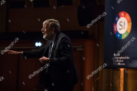 US physicist  William Daniel Phillips, a 1997 co-laureate of the Nobel Prize in Physics, speaks during the International General Conference of Weights and Measures held in Versailles, near Paris, France, 16 November 2018. During the event, representatives from about 60 countries will vote on redefining the Kilogram. After the vote, 'Le Grand K' - a cylinder of a Platinium and Iridium alloy which is the official definition of the kilogram since 129 years - might be replaced by a new definition of the weight, tying it to the so-called Planck constant, which is a fundamental concept in quantum mechanics the is universally valid.