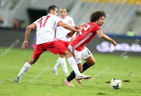 Egypt's Amr Warda (R) in action against Tunisia's Ellyes Skhiri (L) during the Africa Cup of Nations (AFCON) 2019 qualifying soccer match between Egypt and Tunisia in Alexandria, Egypt, 16 November 2018.