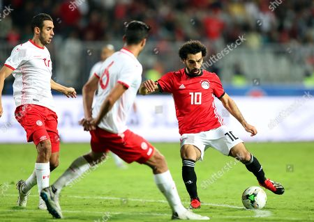 Egypt's Mohamed Salah (R) in action against Tunisia's Bassem Srarfi (L) during the Africa Cup of Nations (AFCON) 2019 qualifying soccer match between Egypt and Tunisia in Alexandria, Egypt, 16 November 2018.