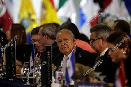 Salvadoran President Salvador Sanchez Ceren (L) speaks at the plenary session of heads of state during the XXVI Ibero-American Summit, in Antigua, Guatemala, 16 November 2018.