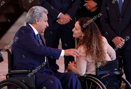 Lenin Moreno, Gabriela Michetti. Ecuador's President Lenin Moreno, left, greets Argentina's Vice President Gabriela Michetti, as they gather for a group photo during the XXVI Ibero-American Summit in Antigua, Guatemala, . The summit comes as waves of people are migrating from Venezuela and Central America to flee poverty, violence and political persecution. The leaders are set to discuss issues such as development and the economy