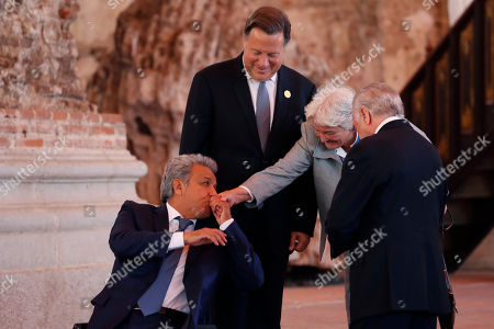 Ecuador's President Lenin Moreno kisses the hand of Uruguay's Vice President Lucia Topolansky, flanked by Panama's President Juan Carlos Varela, second left, and Brazil's President Michel Temer, during the XXVI Ibero American Summit in Antigua, Guatemala, . The summit comes as waves of people are migrating from Venezuela and Central America to flee poverty, violence and political persecution. The leaders are set to discuss issues such as development and the economy