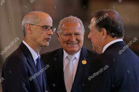 El Salvador's President Salvador Sanchez Ceren, center, listens to Panama's President Juan Carlos Varela and Andorra's head of government Antoni Marti Petit, as they gather for a group photo during the XXVI Ibero-American Summit in Antigua, Guatemala, . The summit comes as waves of people are migrating from Venezuela and Central America to flee poverty, violence and political persecution. The leaders are set to discuss issues such as development and the economy