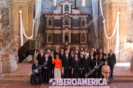 Presidents and heads of delegations pose for a group photo during the XXVI Ibero-American Summit in Antigua, Guatemala, . Pictured are in first row from left; Ecuador's President Lenin Moreno, from left, Brazil's President Michel Temer, Ibero-American Secretary Rebeca Grynspan, Spain's King Felipe, Guatemala's President Jimmy Morales, Andorra's head of government Antoni Marti Petit, Bolivia's President Evo Morales and Argentina's Vice President Gabriela Michetti; second row from left, Panama's President Juan Carlos Varela, Mexico's President Enrique Pena Nieto, Spain's Prime Minister Pedro Sanchez, Costa Rica's President Carlos Alvarado, Honduran President Juan Orlando Hernandez, El Salvador's President Salvador Sanchez Ceren, Nicaragua's Foreign Minister Denis Moncada, Paraguay's President Mario Abdo Benitez; third row from left; Chile's Minister of Women and Gender Identity Isabel Pla, Uruguay's Vice President Lucia Topolansky, Dominican Republic's Foreign Minister Miguel Vargas, Peru's President Martin Vizcarra, Portugal's President Marcelo Rebelo de Sousa, Colombia's Vice President Marta Lucia Ramirez, Venezuela's Foreign Minister Jorge Arreaza and Cuba's Foreign Minister Bruno Rodriguez