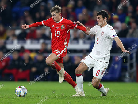 David Brooks of Wales is challenged by Andreas Christensen of Denmark.