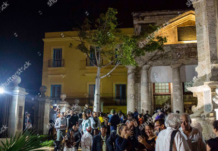 People begin their exit after marking the 499th anniversary of the city's founding, in Havana, Cuba, . Part of the celebration includes the tradition of making wishes while walking three times around a ceiba tree, pictured, touching it or even kissing the tree, which is located near the spot where the city was officially founded