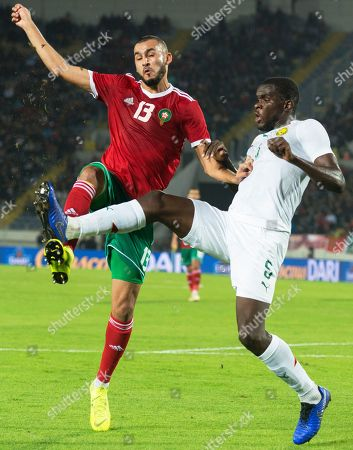 Morocco's Khalid Boutaib (L) in action against Cameroon's Michael Ngadeu-Ngadjui (R) during the Africa Cup of Nations (AFCON) 2019 qualifying soccer match between Morocco and Cameroon in Casablanca, Morocco, 16 November 2018.