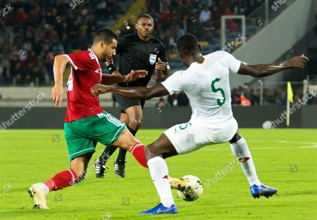 Morocco's Yassine Bounou (L) in action against Cameroon's Michael Ngadeu-Ngadjui (R) during the Africa Cup of Nations (AFCON) 2019 qualifying soccer match between Morocco and Cameroon in Casablanca, Morocco, 16 November 2018.